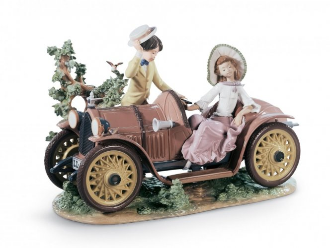 Young Couple with Car Sculpture. Limited Edition